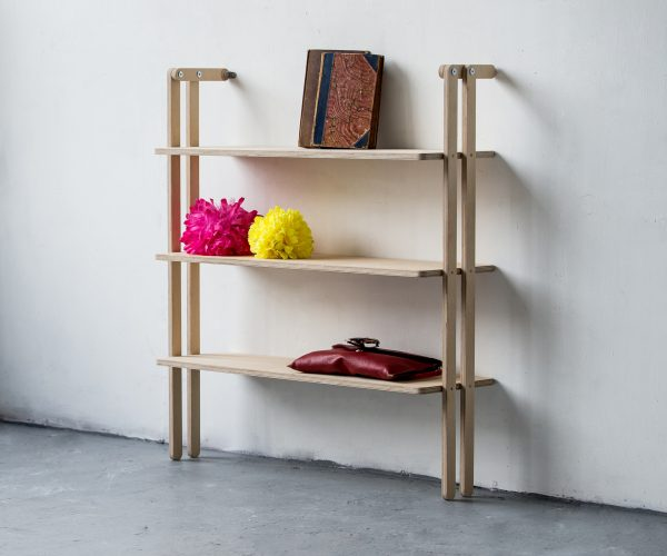 Everything Goes - Slant shelving for boats and angled walls. Beatifully made in birch ply with a clever system to fit angled or straight walls. Shown here against a 90 degree wall