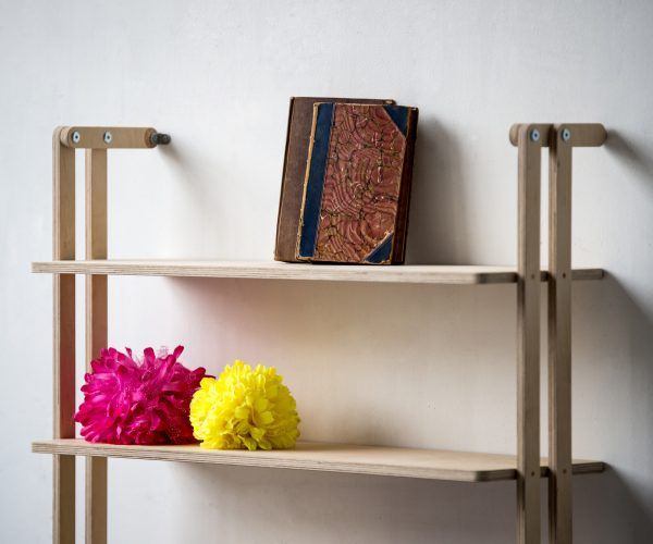 Everything Goes - Slant Shelving in Birch ply - displaying pompoms and vintage books
