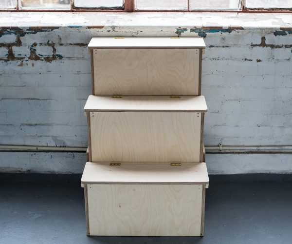 Everything Goes - assembled Storage Steps in birch ply with brass hinges - viewed from the front